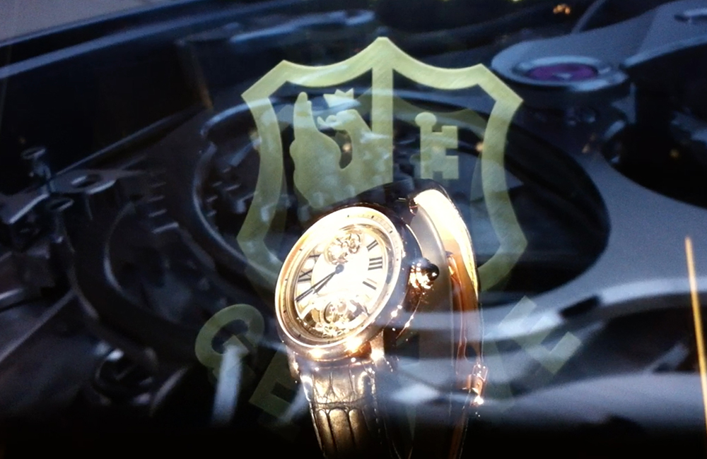 Cartier uses a giant holographic display case at the SIHH 2012.