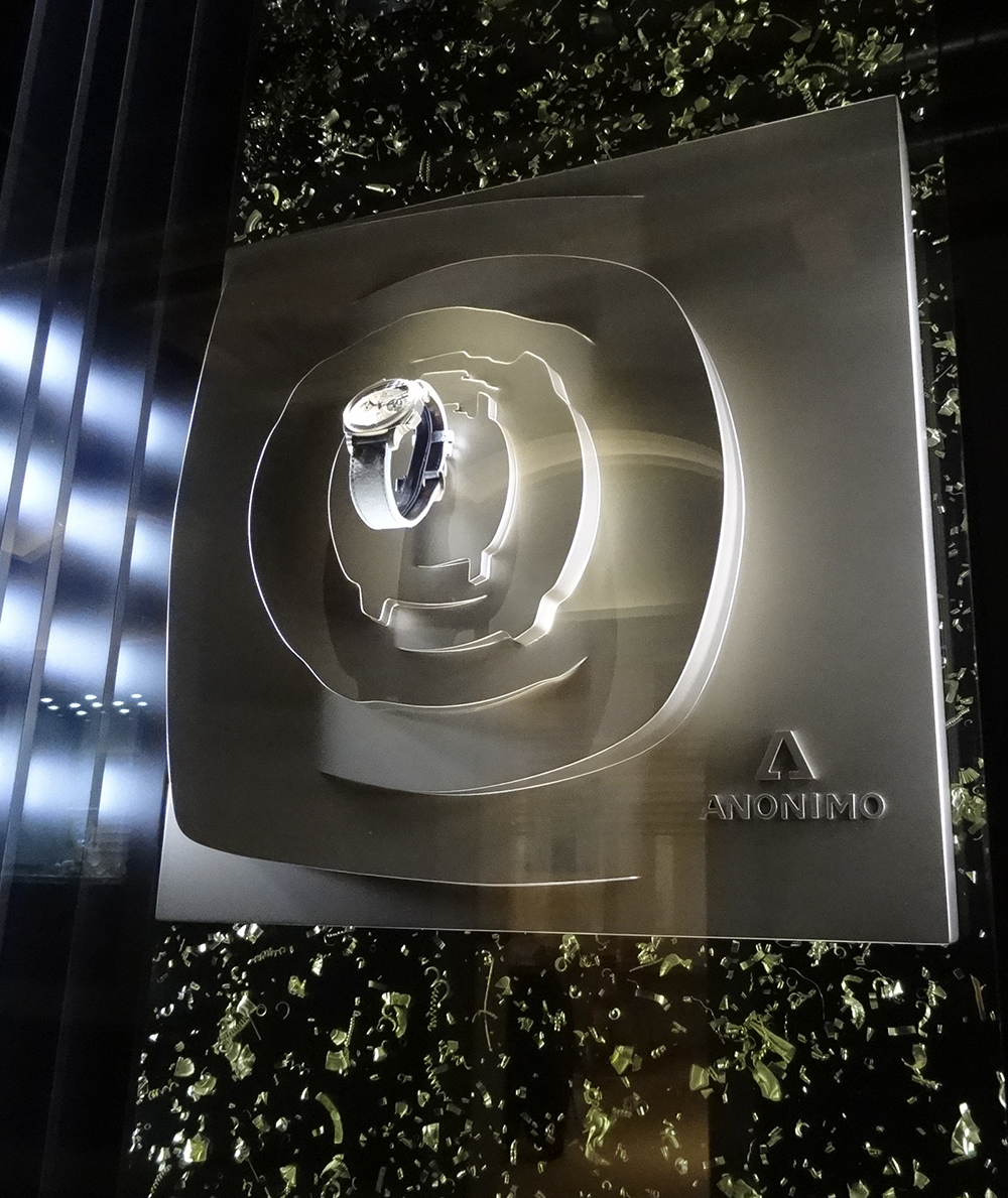 Anonimo Watches at Baselworld 2014. Tricks of the light highlight a multi-faceted bronze sculpture.
