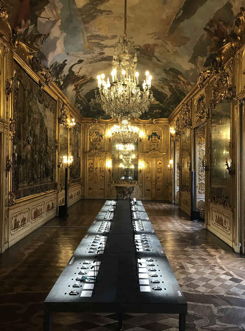 A free access table for the Grand Prix d'Horlogerie de Genève at the Palazzo Clerici in Milano.