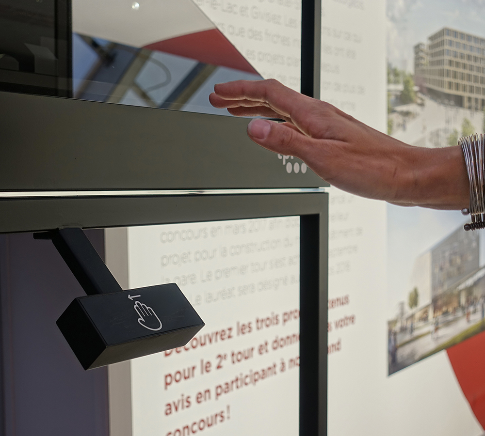 Interactive holographic display case for the TPF with architectural 3D models. Just swipe it!
