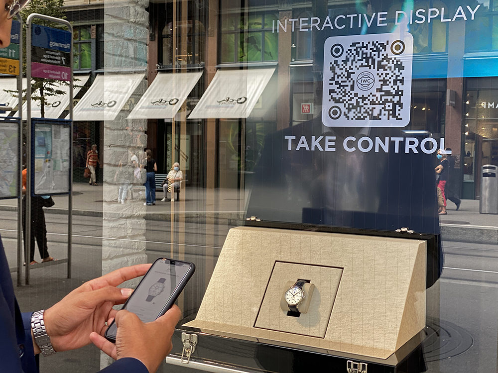 TAKE CONTROL! IWC and its connected display that can be controlled in the street.