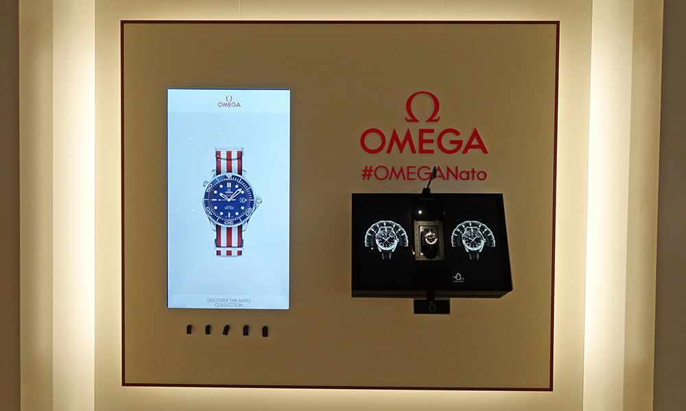 Omega Magic Box display at Baselworld: Three watches matched with three different straps.